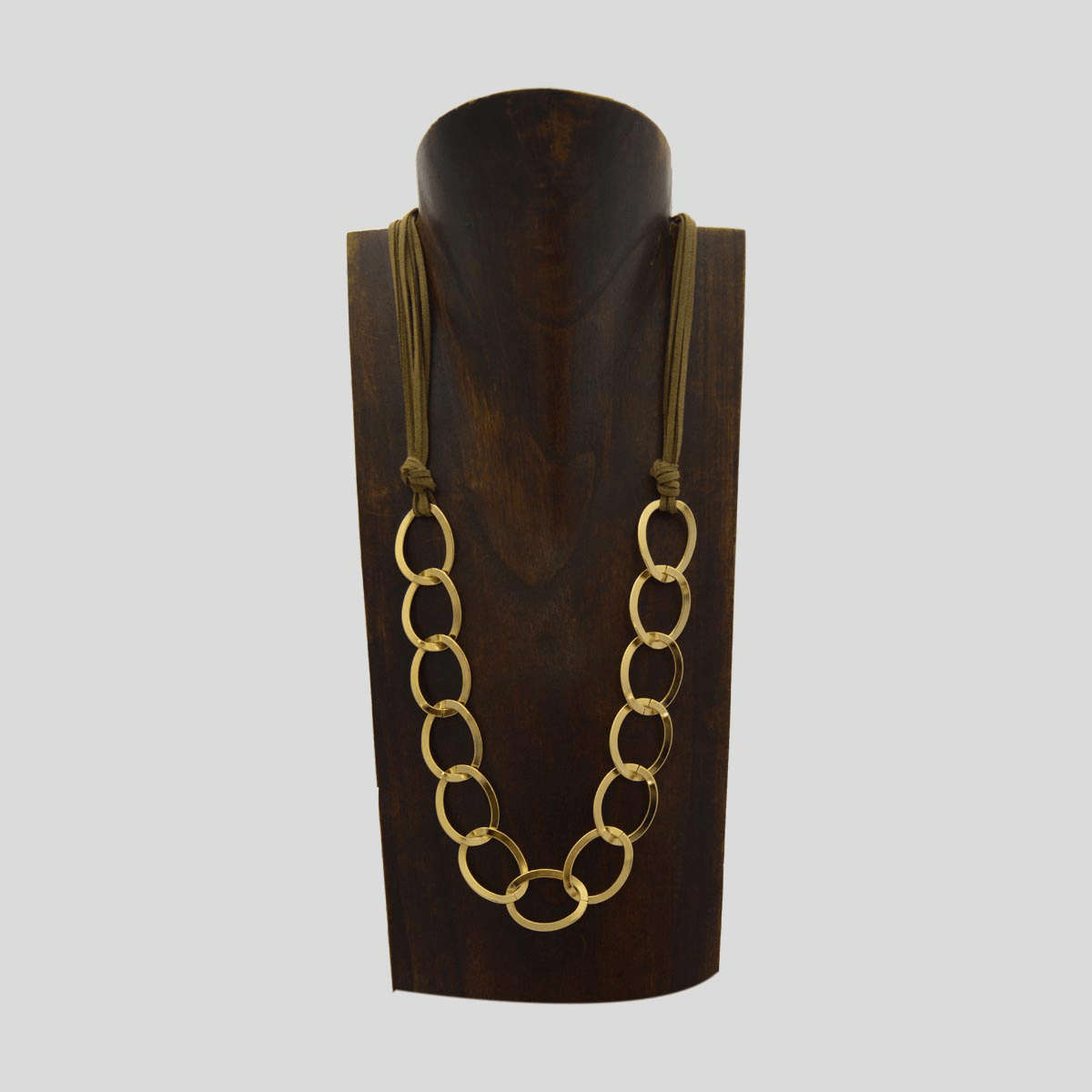 Mississippi medium necklace of golden links caught with brown suede on the neck