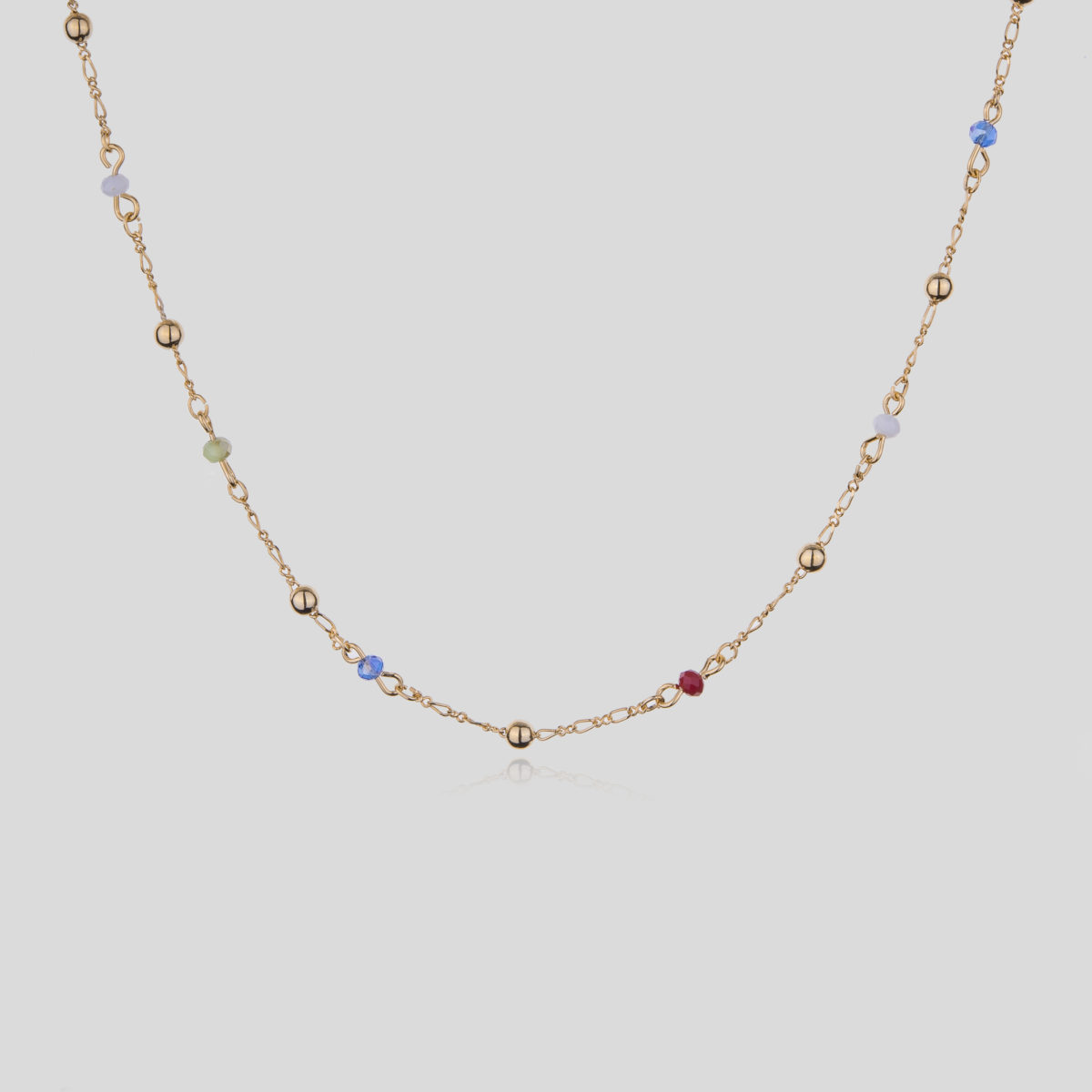 Formentera. 8 Karat gold-plated thin metal choker with golden balls and colored crystals interspersed