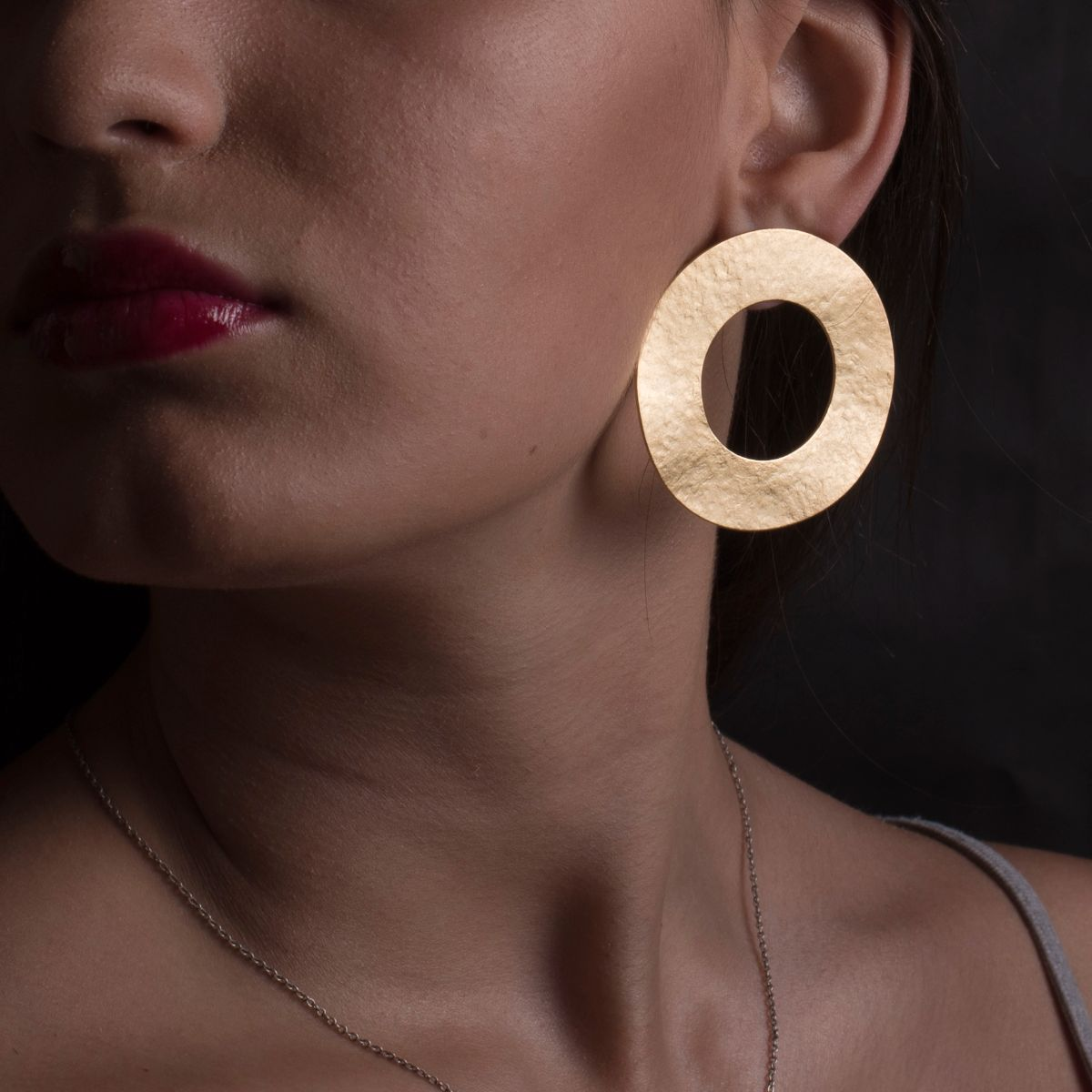 Minerva wide circle matte gold earring with snap closure