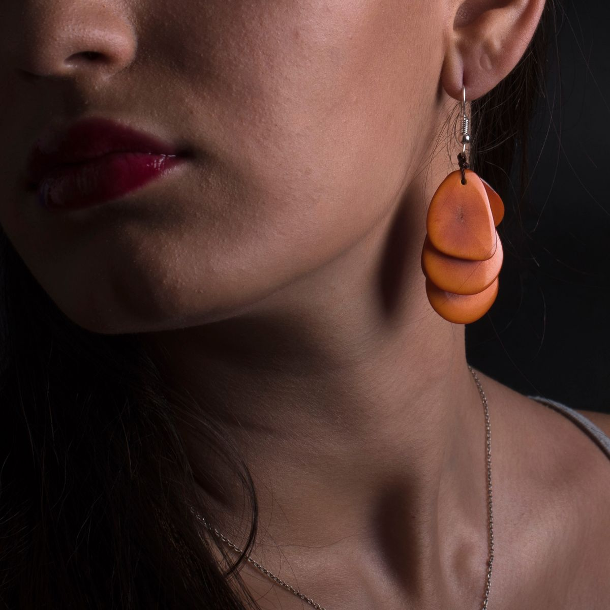 Long earring petals with five orange tagua seed blades