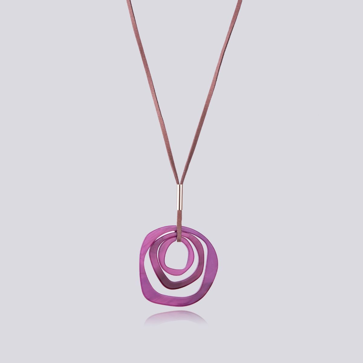Huracán brown suede long pendant with several purple circles.