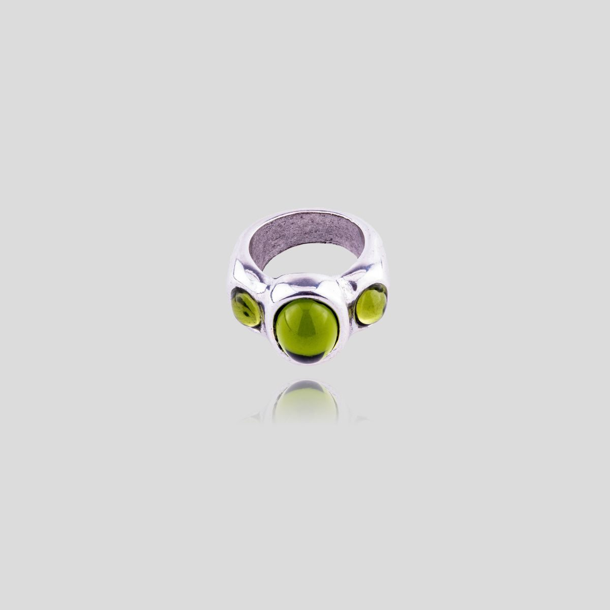 Auriga silver plated ring with inlay of three green Murano crystals.