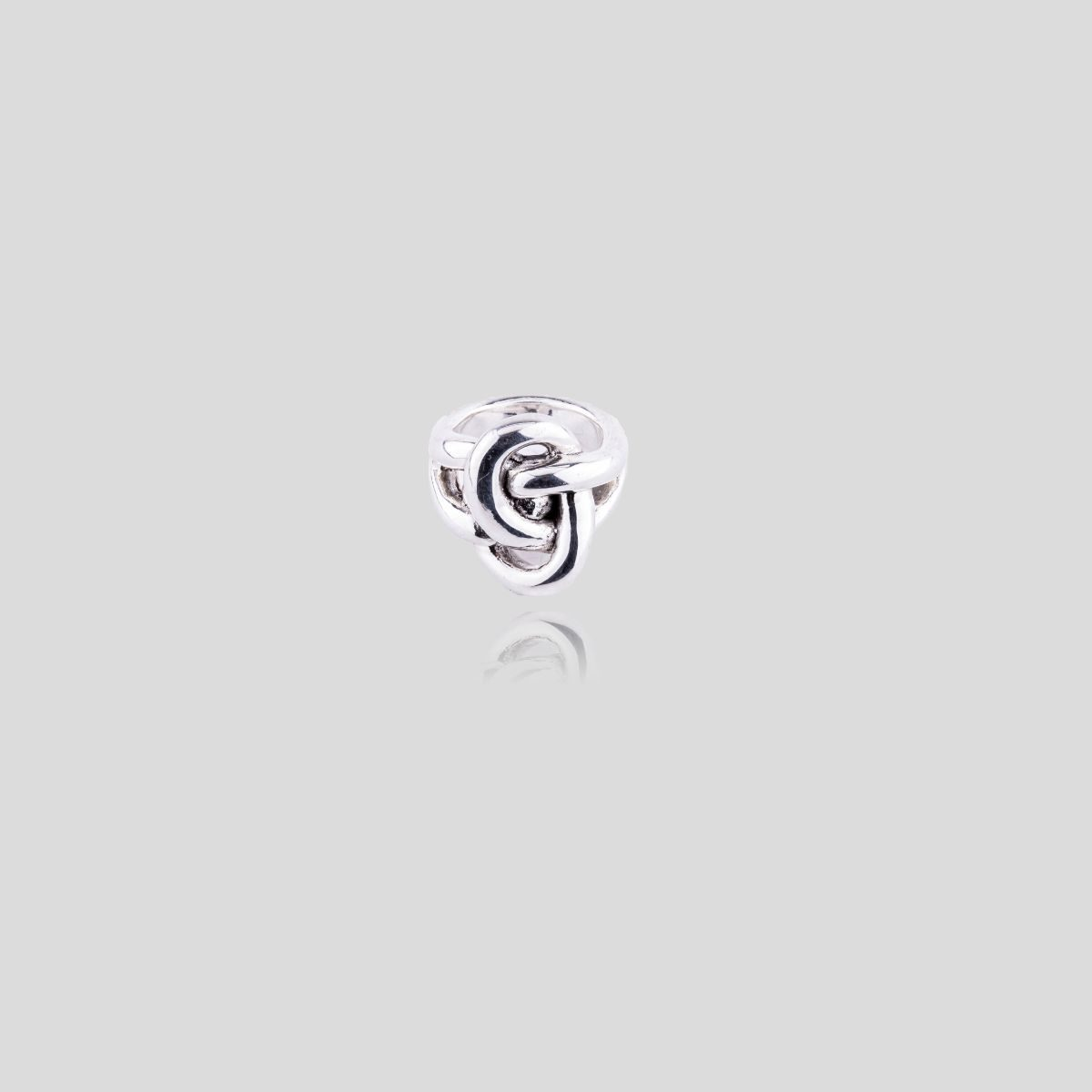 Escorpio sterling silver ring with ribbon or knot motif