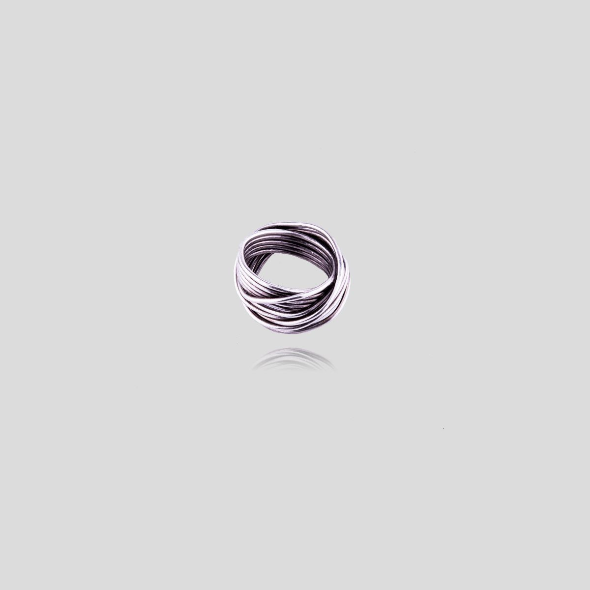 Laurel silver zamak ring with original design as a metal coil