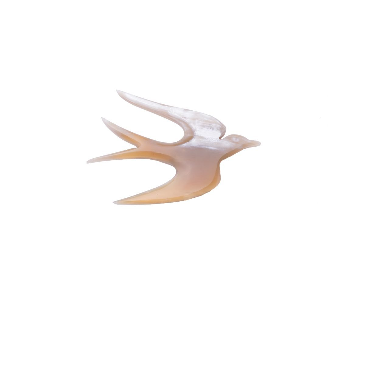 Golondrina natural horn brooch in the shape of a swallow.