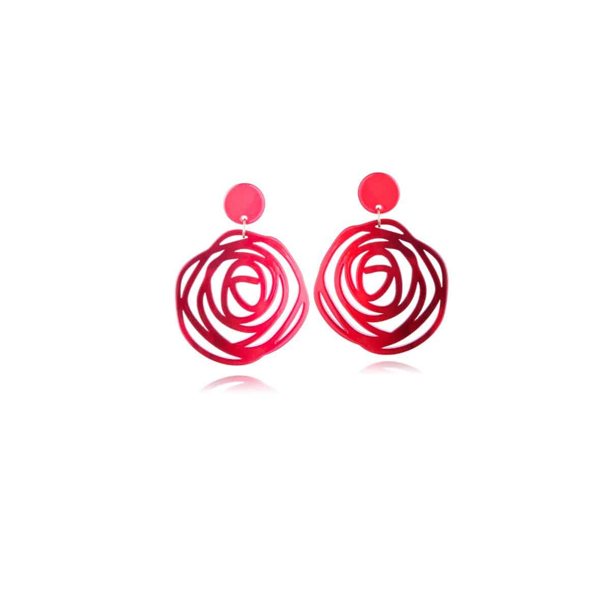 Twister earrings, red resin with openwork circular shape.