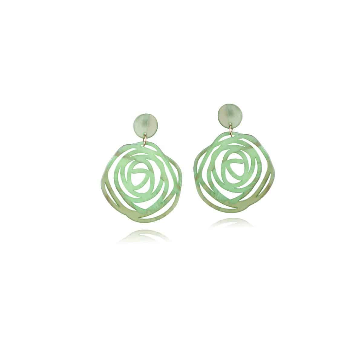 Twister earrings, green resin with openwork circular shape.